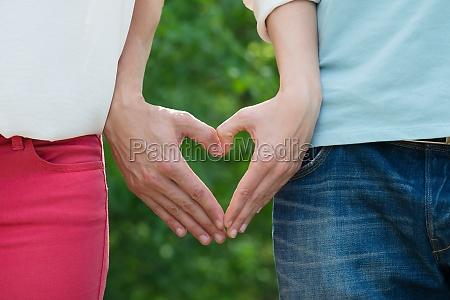 couple making heart shape