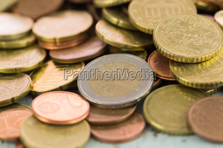 pile with various euro coins detail