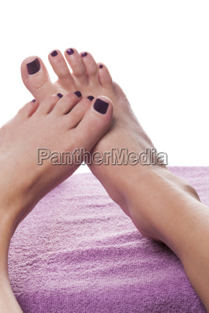 female feet with pedicure as a