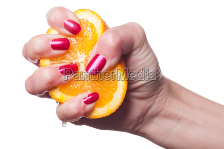 hand with neat fingernails and orange