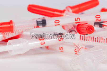 small syringes with hypodermic needles and