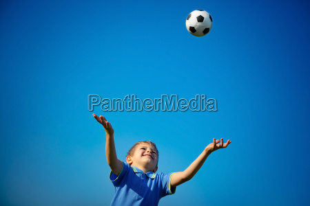 happy boy playing ball