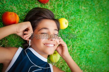 cheerful boy listening to music