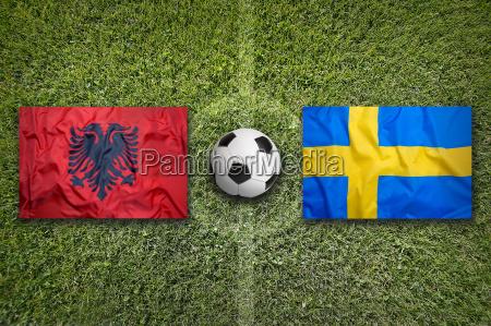 albania vs sweden flags on soccer