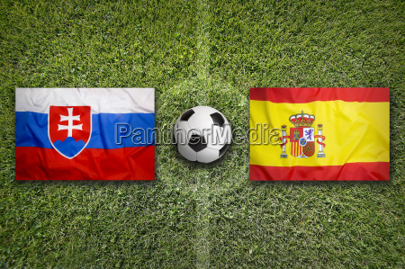 slovakia vs spain flags on soccer