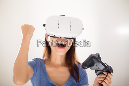 excited asian woman play game with