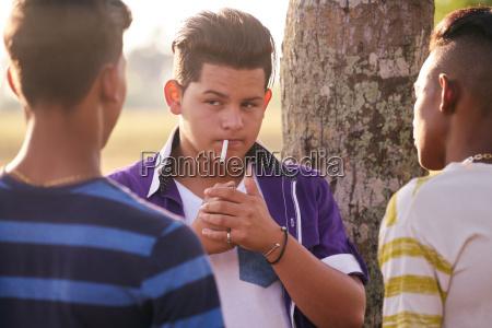 group of teens boy smoking cigarette