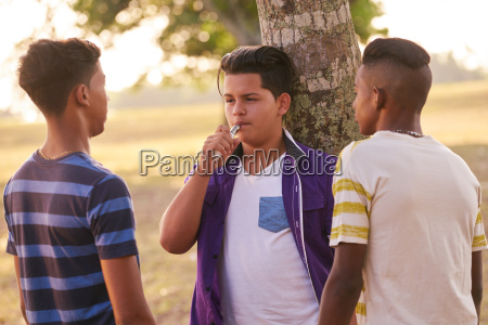 group of teenagers in park boy