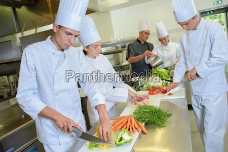 team of chefs preparing vegetables