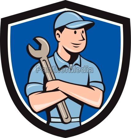 mechanic arms crossed spanner crest cartoon