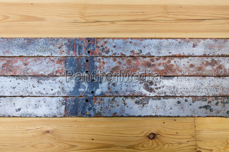 old wooden boards and metal tape