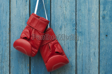 pair of boxing gloves hanging in
