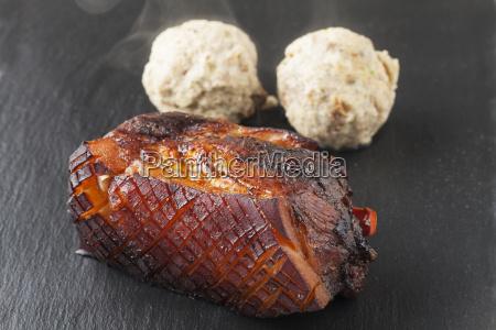 whole bavarian roasted pork on slate
