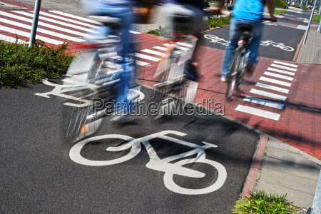 bicycle road sign and bike riders