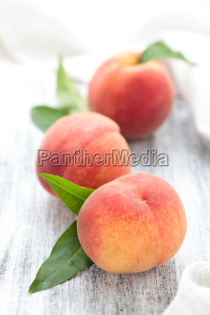 peaches on rustic table