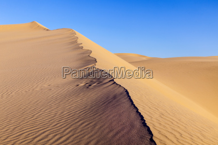 sand dune in sunrise in the