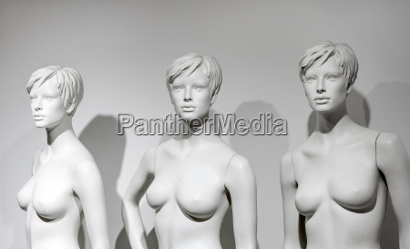 naked female dummys in a window