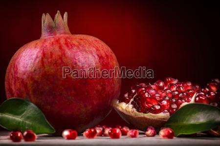 pomegranate against red background