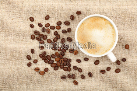 latte cappuccino cup and coffee beans