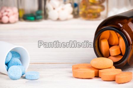 orange pills in dark brown glass