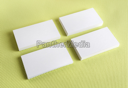 white business cards on a green