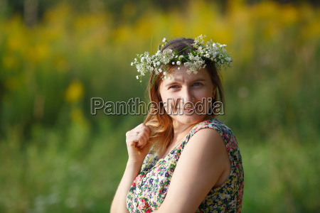 woman with wreath on her head