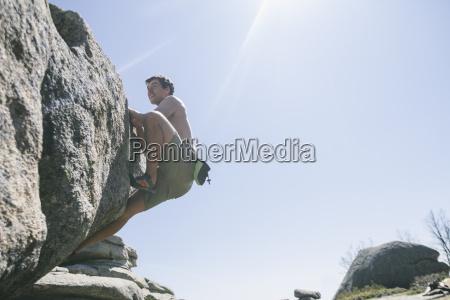 spain shirtless climber climbing on a