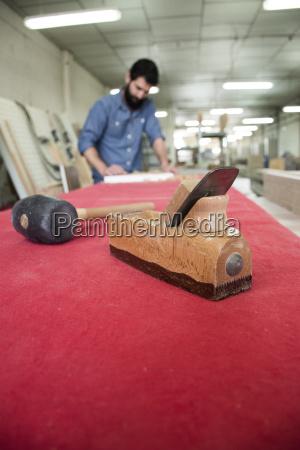 carpenter tools with unfocused carpenter sanding