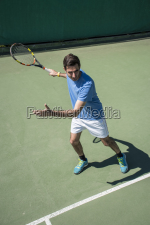 tennis player prepared to hitting a
