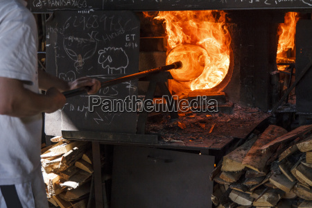 man using a furnace in a
