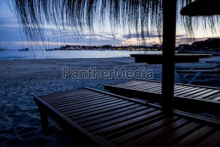 mallorca straw umbrellas and beach chairs