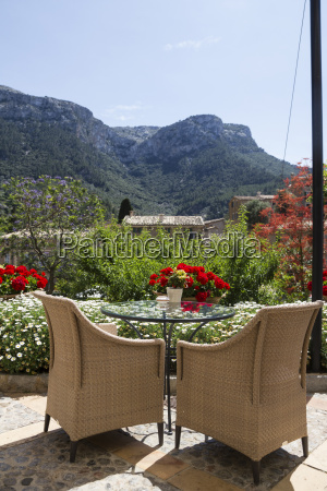 wicker chairs on a terrace mountains