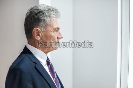 senior businessman looking out of the