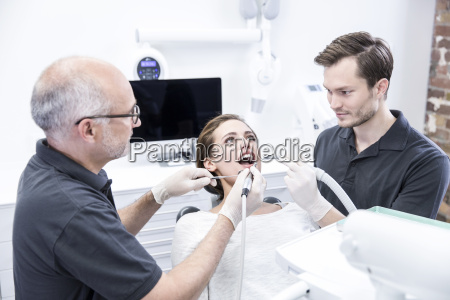 young woman getting dental treatment