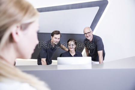 doctors and receptionist at reception of