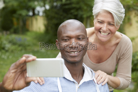 portrait of couple taking selfie with