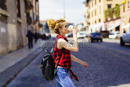 italy verona woman drinking coffee to