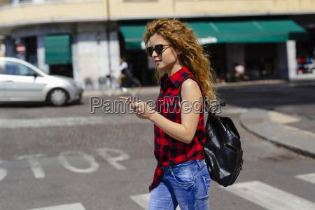 italy verona woman crossing street looking