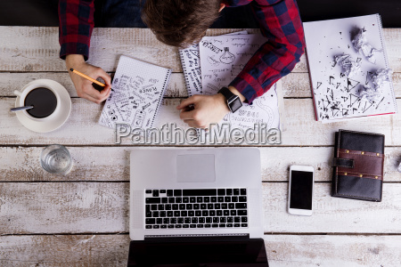 man working at desk with laptop