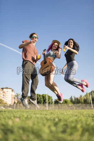 friends having fun and jumping for