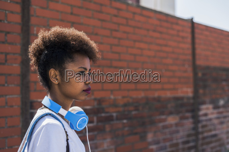 young woman wearing headphones in front