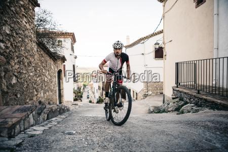 mountain biker riding uphill in mountain
