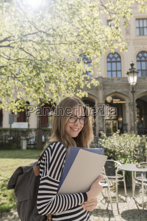 portrait of smiling student outdoors