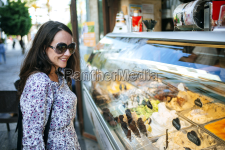 woman looking at ice cream in