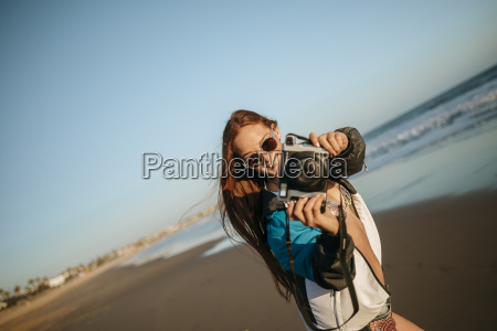 young woman taking photos on the