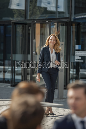 confident businesswoman outside office building
