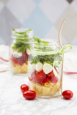 calabrese salad with pasta tomatoes mozzarella