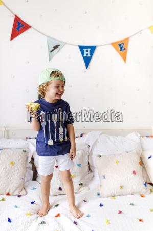 portrait of happy little boy standing