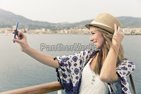 smiling woman on cruise liner taking