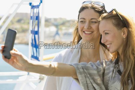 two smiling women taking a selfie